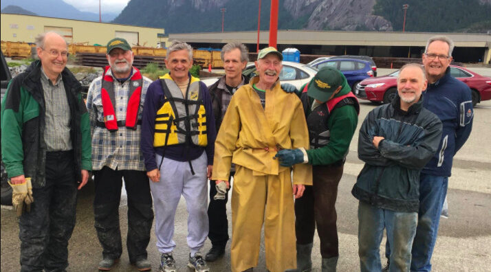 Volunteers at Squamish Terminals wrapping creosote pilings
